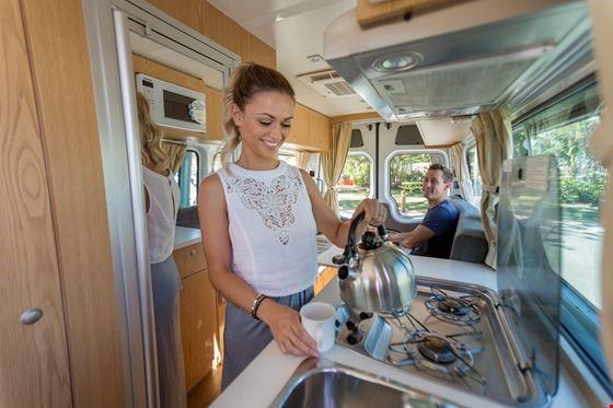 Woman Holding a Kettle - Campervan Hire Hobart - Campervan Rental Shop