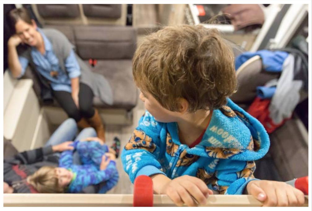 Kid Looking at His Family - Campervan Hire Newcastle - Campervan Rental Shop