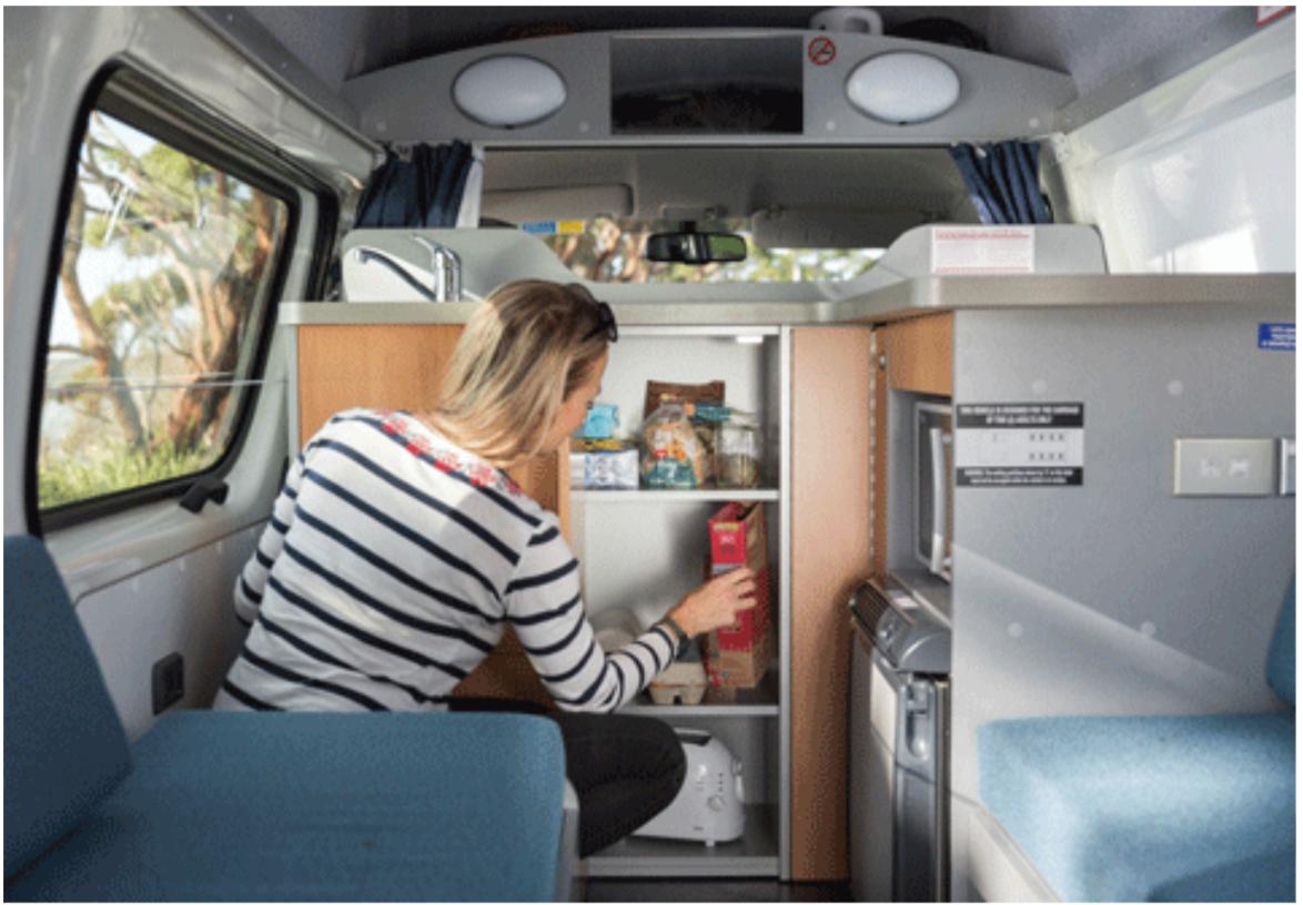 Woman Stacking Food - Campervan Hire Sydney - Campervan Rental Shop