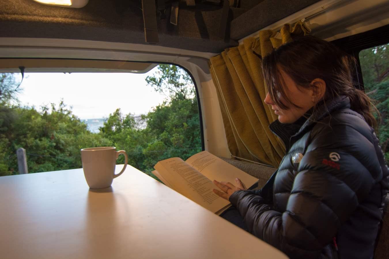 Woman Reading a Book - RV Hire Canberra - Campervan Rental Shop