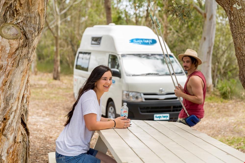 Woman Smiling Outside Cheapa - RV Rental Canberra - Campervan Rental Shop