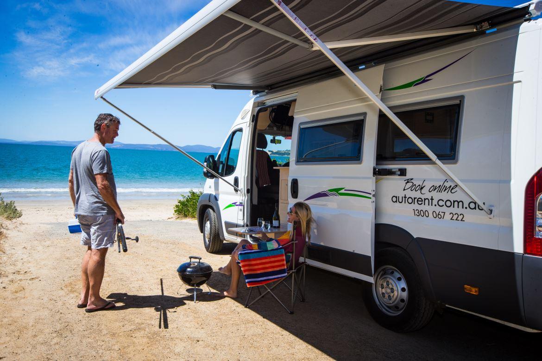 Couple Talking Outside Hertz Berth - Motorhome Rental Canberra - Campervan Rental Shop