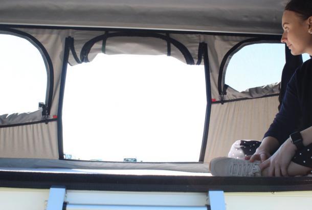 Woman Looking Outside - Camper Hire Broome - Campervan Rental Shop
